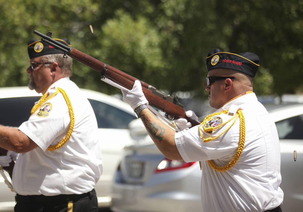 A 21-gun salute by the Disabled American Veterans Black Mountain Chapter 12 during a Memorial Day ceremony at the Southern Nevada Veterans Memorial Cemetery in Boulder City on Monday, May 29, 2017 ...