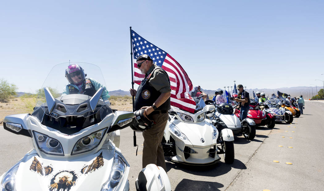 Janice Adams and her husband Robert Adams, who is a veteran, join hundreds of other motorcyclists to attend a memorial service for fallen soldiers at the Southern Nevada Veterans Cemetery in Bould ...