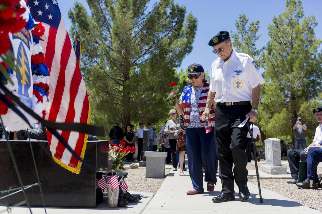 Anita Gargus and her husband Air Force Veteran John Gargus  pay honor to fallen soldiers during a memorial service at the Southern Nevada Veterans Cemetery in Boulder City, Sunday, May 28, 2017. E ...