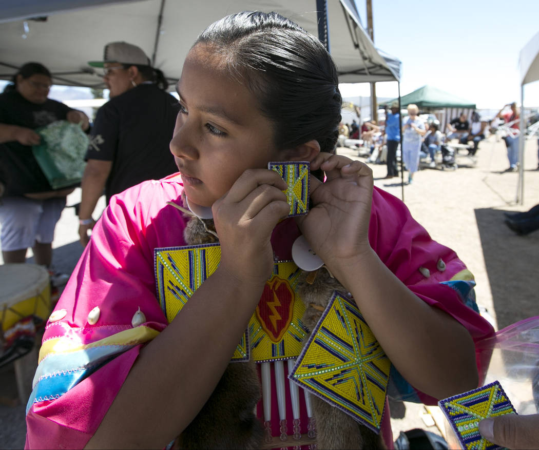 Echo Marie Hummingbird Jake puts on her earrings before participating in the grand entry ceremonies during the 28th annual Snow Mountain Pow Wow on Saturday, May 27, 2017. Richard Brian Las Vegas  ...