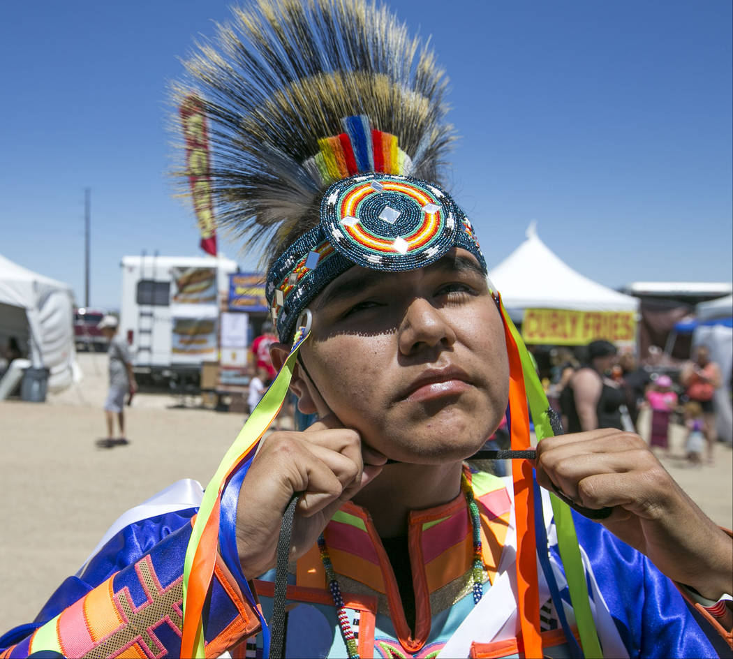 Cason Deschine, 15, of Cedar City, Utah, adjust his headpiece before participating in the grand entry ceremonies during the 28th annual Snow Mountain Pow Wow on Saturday, May 27, 2017. Richard Bri ...