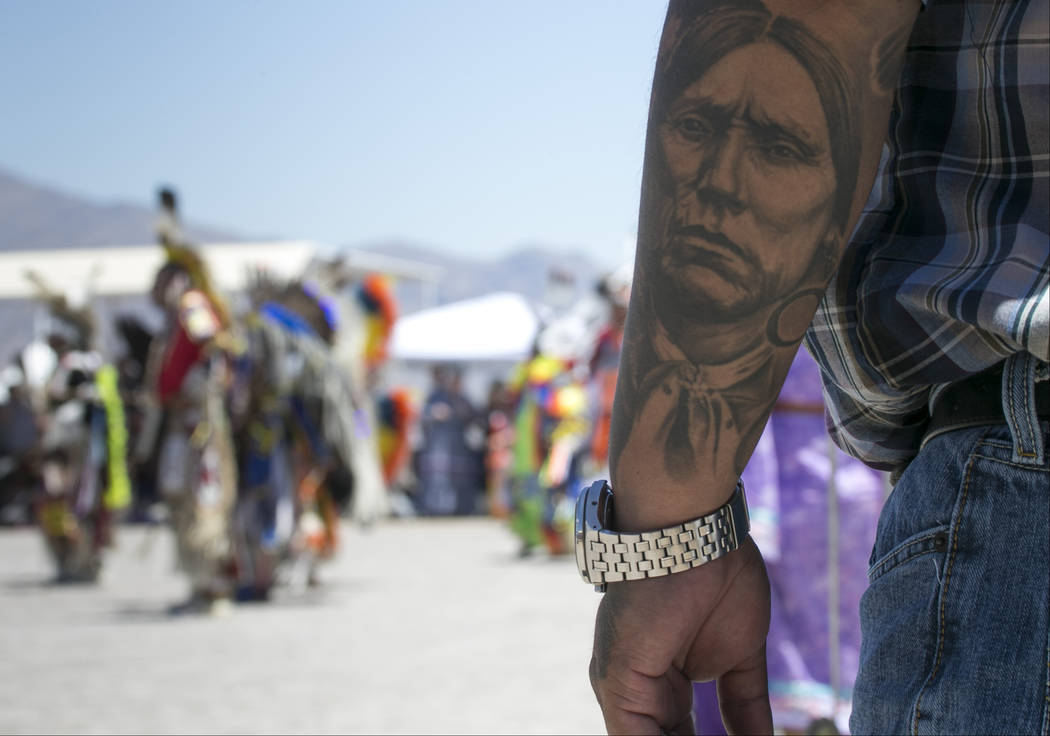 A spectator watches the grand entry ceremonies during the 28th annual Snow Mountain Pow Wow on Saturday, May 27, 2017. Richard Brian Las Vegas Review-Journal @vegasphotograph