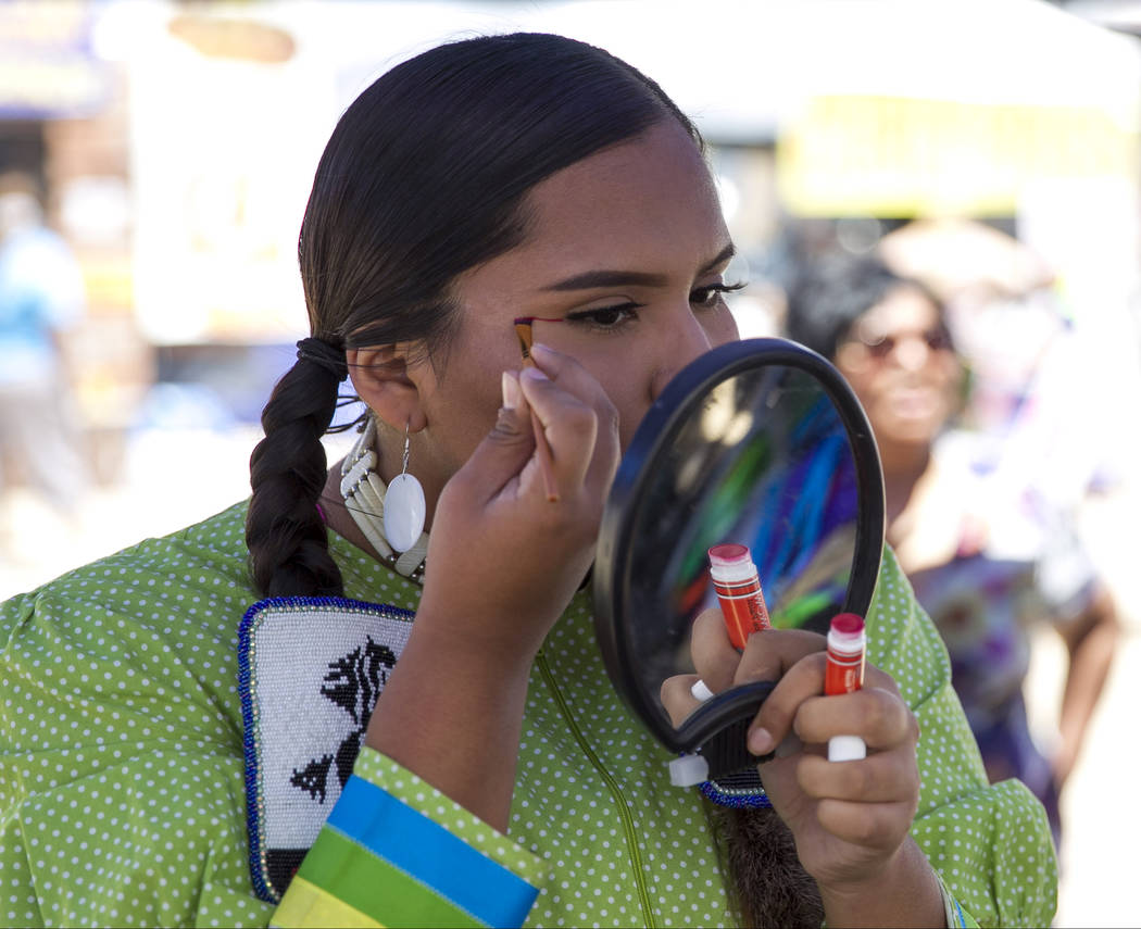Wyomee Cooke, of Phoenix, Arizona, touches up her makeup before dancing in the grand entry ceremonies during the 28th annual Snow Mountain Pow Wow on Saturday, May 27, 2017. Richard Brian Las Vega ...