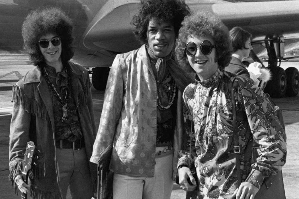 This Aug. 21, 1967 file photo shows bass guitarist Noel Redding, left, guitarist Jimi Hendrix, center, and drummer Mitch Mitchell, of the Jimi Hendrix Experience, at Heathrow airport in London. 19 ...