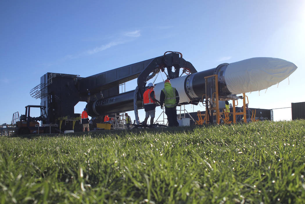 In this May 19, 2017 photo supplied by Rocket Lab, engineers work with the Electron rocket at the launch site on the Mahia Peninsula in the North Island of New Zealand. New Zealand has never had a ...