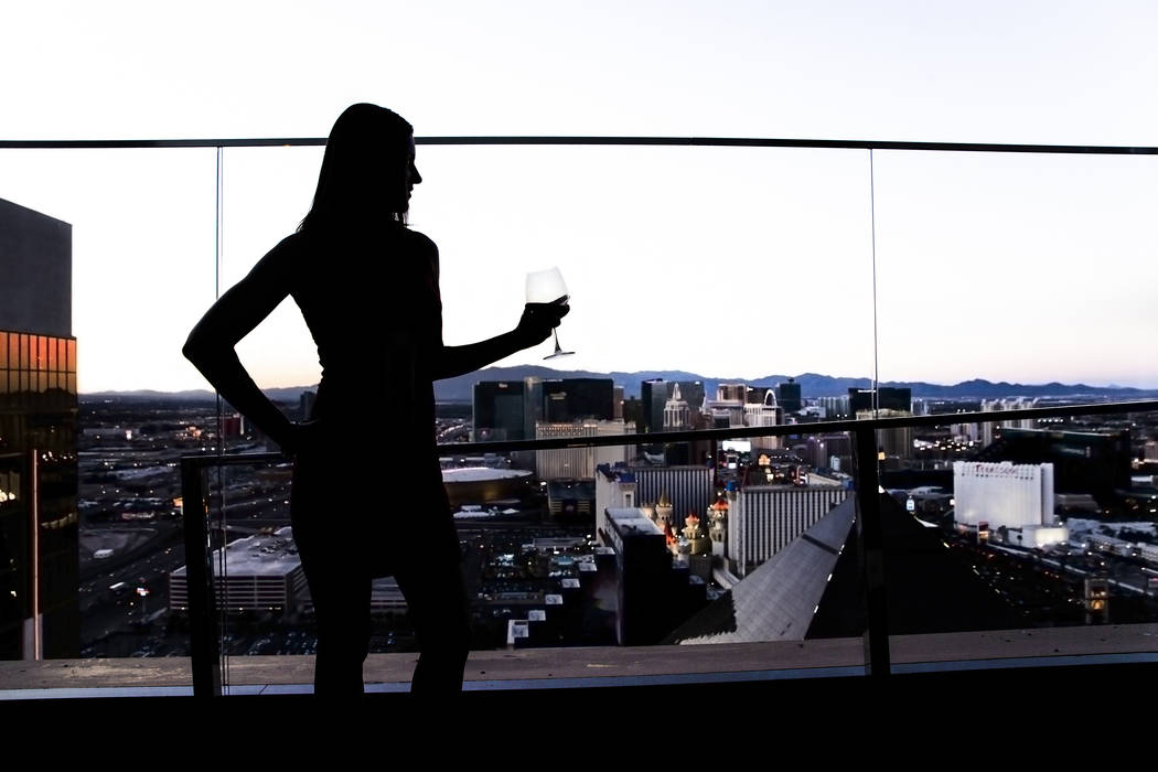 Stefanie Gatsinaris drinks a glass of wine while taking in the view from Skyfall Lounge during For the Love of Cocktails charity event for breast cancer on Friday, May 19, 2017, at the Delano hote ...