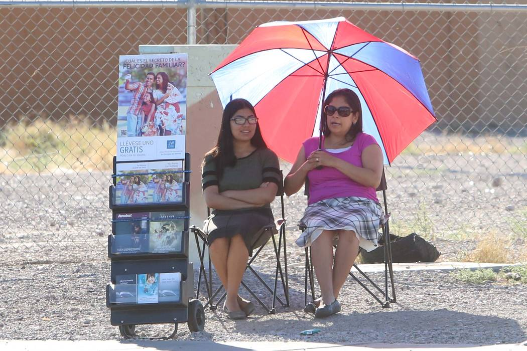 Two women, who declined to give their names, protect themselves from the sun on Pecos Road in east Las Vegas on Monday, May 22, 2017. (Bizuayehu Tesfaye Las Vegas Review-Journal) @bizutesfaye