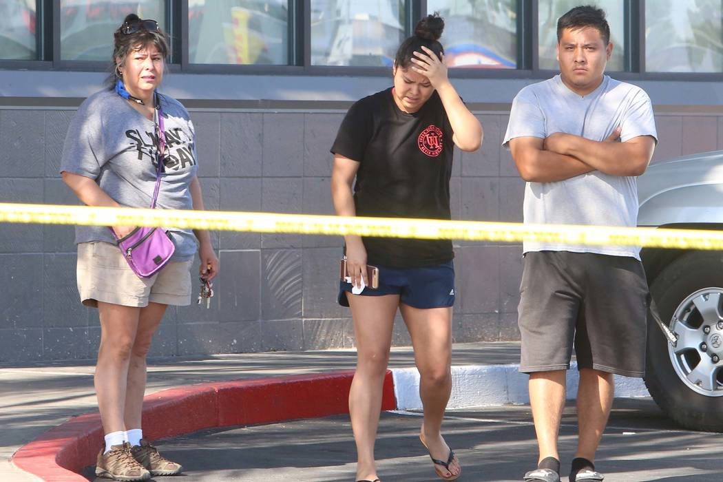 Family members of a man who was shot and killed inside a 7-Eleven store gather outside the store on East Lake Mead Boulevard and Pecos Road on Monday, May 22, 2017. (Bizuayehu Tesfaye Las Vegas Re ...