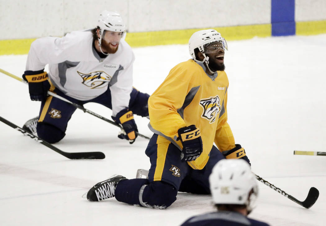 Nashville Predators defenseman P.K. Subban, right, jokes with teammates during practice at their NHL hockey facility Thursday, May 25, 2017, in Nashville, Tenn. At left is right wing James Neal. ( ...