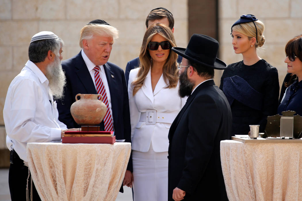 U.S. President Donald Trump (2nd L) and first lady Melania Trump arrive to leave notes at the Western Wall in Jerusalem May 22, 2017.  REUTERS/Jonathan Ernst