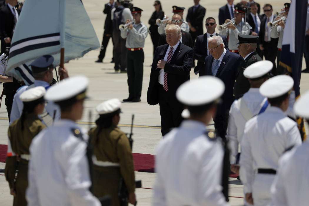 President Donald Trump centre, participates in an arrival ceremony at Ben Gurion International Airport, Monday, May 22, 2017, in Tel Aviv. Trump opened his first visit to Israel Monday, a two-day  ...