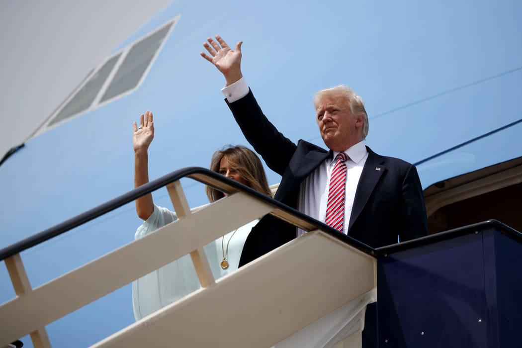 President Donald Trump, right,  and first lady Melania Trump wave as they board Air Force One for Israel, the next stop in Trump's international tour, at King Khalid International Airport, Monday, ...
