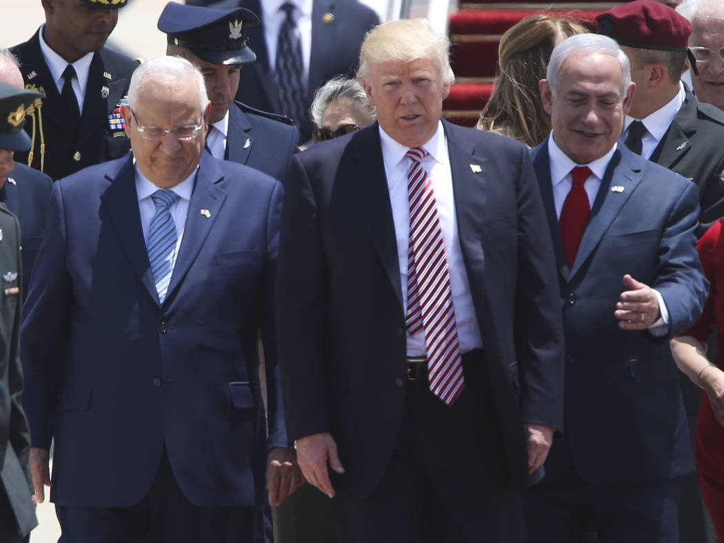 US President Donald Trump walks on his arrival accompanied by the Israeli President Rueben Rivlin, right, and Prime Minister Benjamin Netanyahu in Tel Aviv, Monday, May 22,2017. (Oded Balilty/AP)