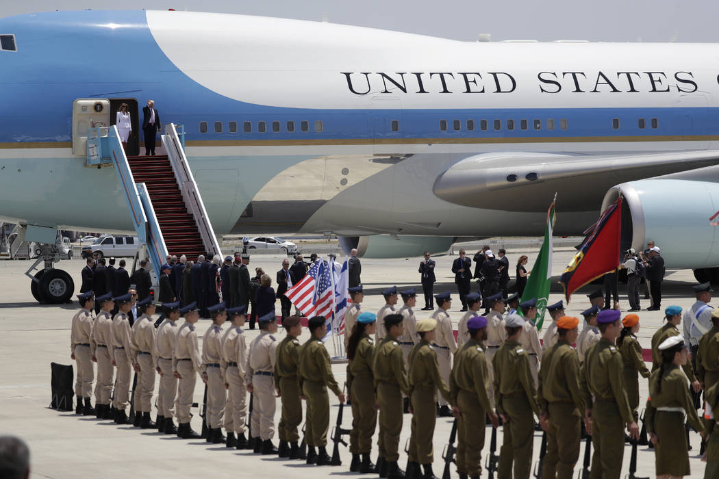President Donald Trump and first lady Melania Trump disembark Air Force One on arrival at Ben Gurion International Airport, Monday, May 22, 2017, in Tel Aviv. Trump opened his first visit to Israe ...