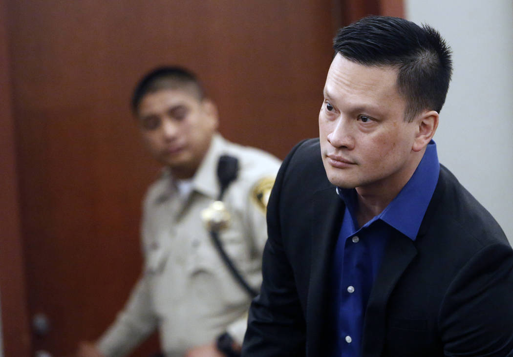 Doctor Binh Minh Chung prepares to leave the courtroom after a jury found him guilty at the Regional Justice Center on Monday, May 22, 2017, in Las Vegas. Chung is accused of videotaping himself h ...