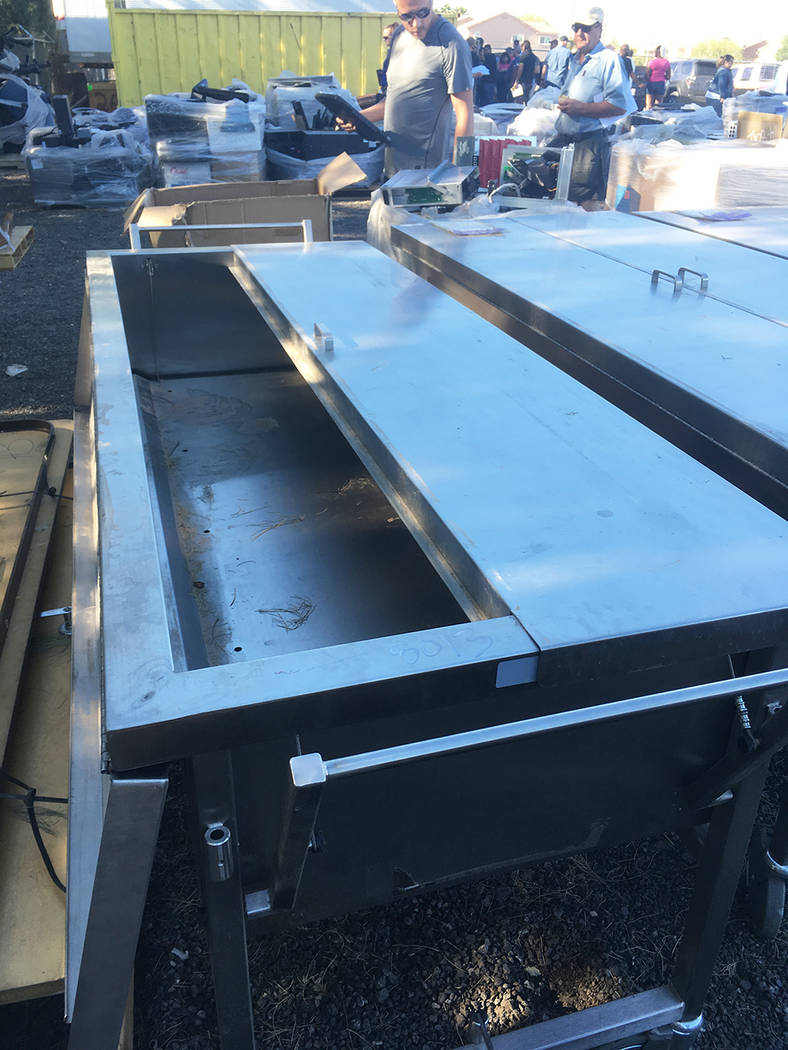 Former cadaver-storage tables were among the more macabre offerings at the Clark County government surplus auction. (Brian Sandford/View) @nweditor