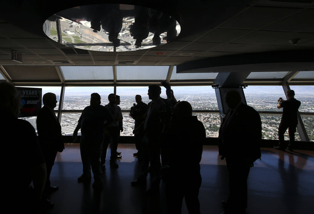 Vegas Golden Knights owner Bill Foley, far left, talks about the team's multiyear television deal with ROOT SPORTS at the Stratosphere hotel-casino observation deck in Las Vegas on Tuesday, May 23 ...