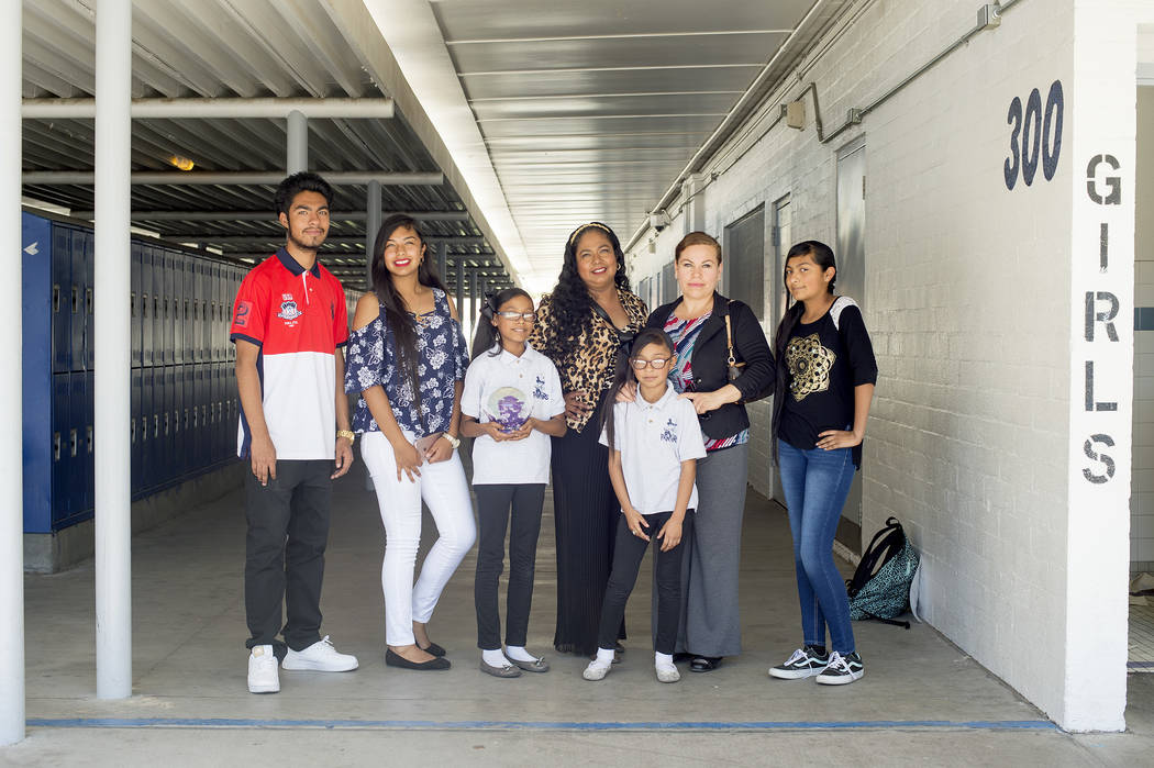 Second from right, Alicia Davalos, poses with Laura Lopez, third from right, and her children at John C. Fremont Middle School on Tuesday, May 23, 2017, in Las Vegas. Lopez has been very active in ...