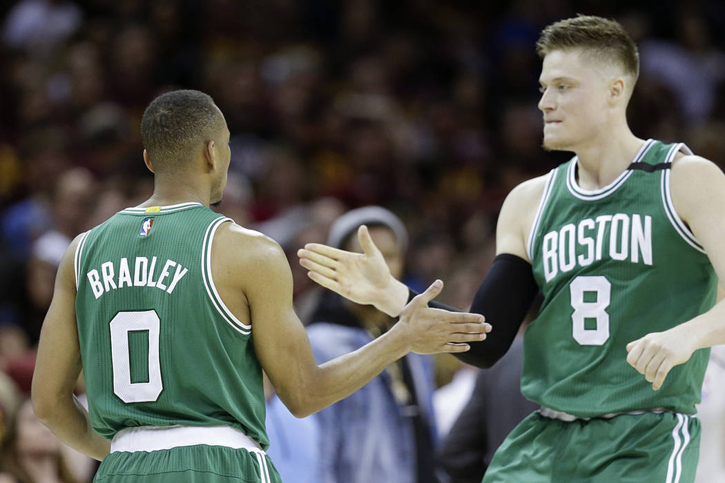 Boston Celtics' Avery Bradley (0) celebrates with Jonas Jerebko (8) after hitting the game winning shot against the Cleveland Cavaliers during the second half of Game 3 of the NBA basketball Easte ...