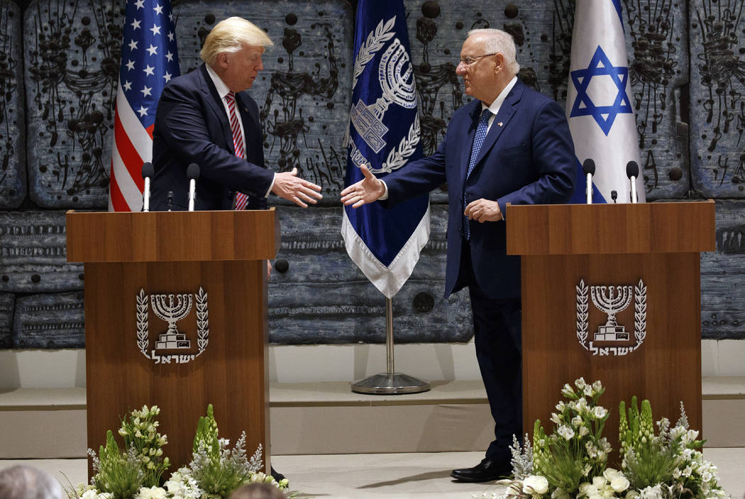 President Donald Trump, left, shakes hands with Israeli President Reuven Rivlin after delivering statements, Monday, May 22, 2017, in Jerusalem. Trump opened his first visit to Israel Monday, a tw ...