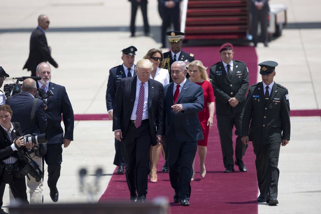President Donald Trump and Israeli Prime Minister Benjamin Netanyahu walk during welcome ceremony in Tel Aviv, Monday, May 22,2017. (Oded Balilty/AP)