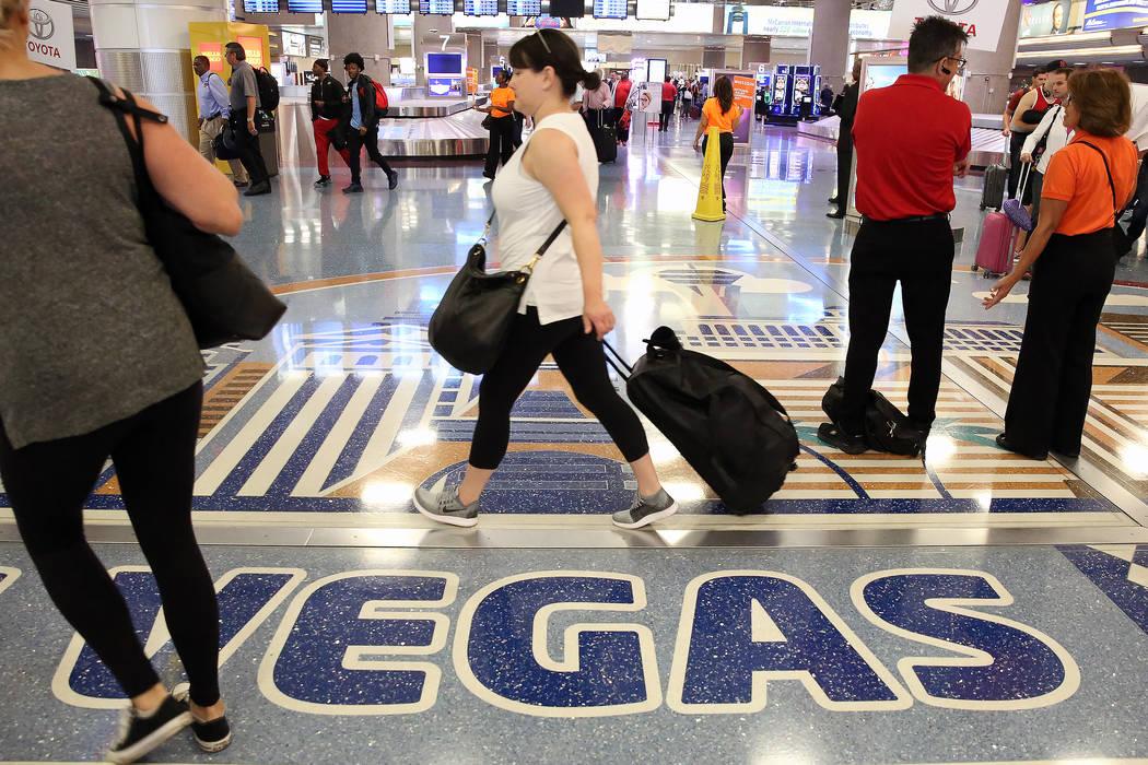 Passengers arrive at McCarran International Airport on Tuesday, May 23, 2017, in Las Vegas. Bizuayehu Tesfaye Las Vegas Review-Journal @bizutesfaye