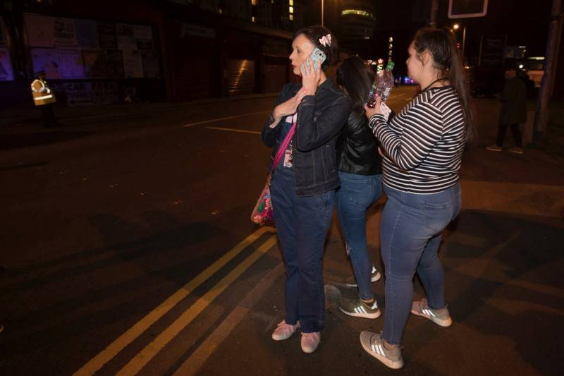 Concert goers react after fleeing the Manchester Arena in northern England where U.S. singer Ariana Grande had been performing in Manchester, Britain, May 22, 2017. (Reuters)