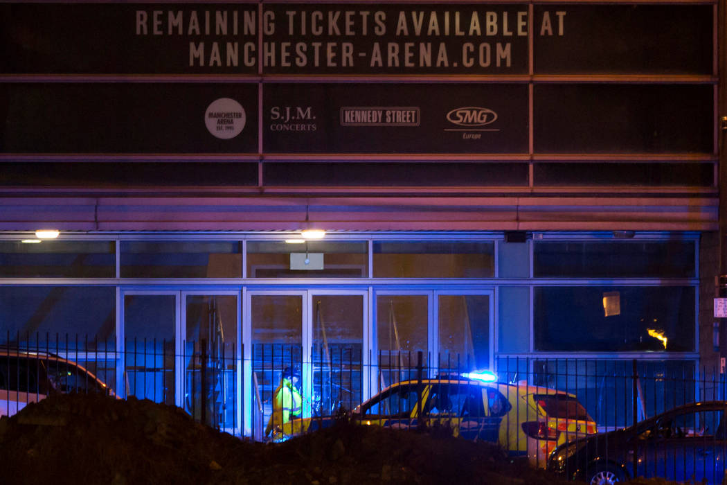 Police are seen outside the Manchester Arena in northern England where U.S. singer Ariana Grande had been performing in Manchester, Britain, May 22, 2017. (Reuters)