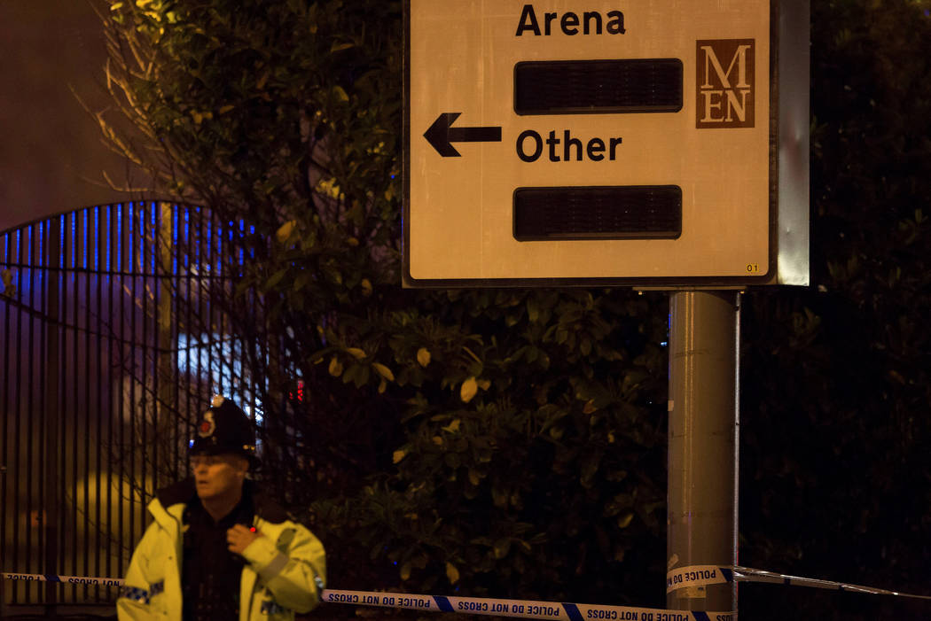 A police officer stands outside the Manchester Arena, where U.S. singer Ariana Grande had been performing in Manchester, northern England, Britain May 22, 2017. (Reuters)