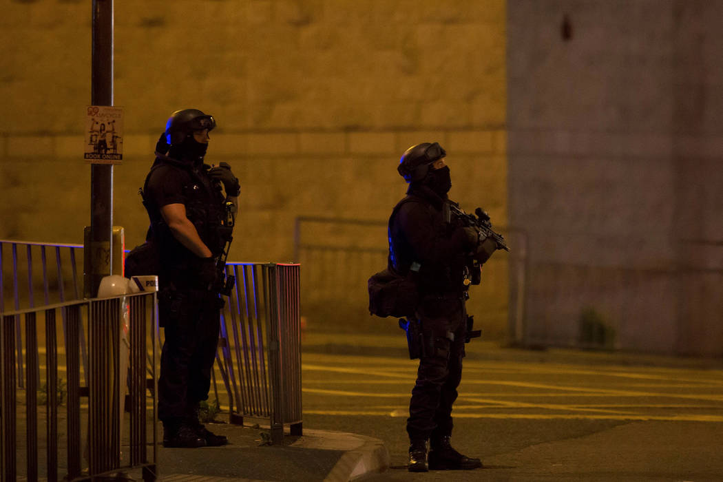 Armed police officers stand outside the Manchester Arena, where U.S. singer Ariana Grande had been performing in Manchester, northern England, Britain May 22, 2017. (Reuters)