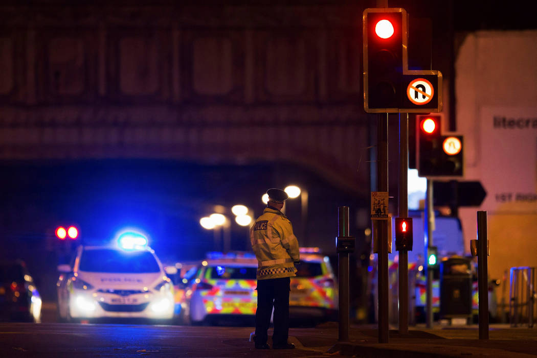 Police vehicles and a police officer are seen outside the Manchester Arena, where U.S. singer Ariana Grande had been performing in Manchester, northern England, Britain May 22, 2017. (Reuters)