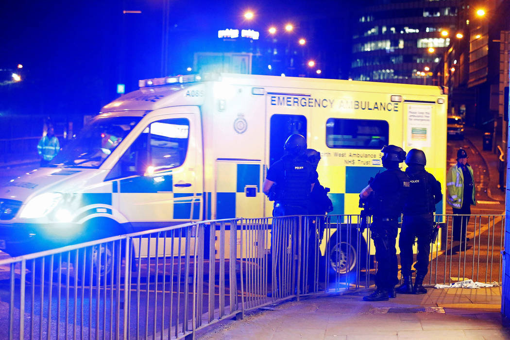 Armed police officers stand near the Manchester Arena, where U.S. singer Ariana Grande had been performing, in Manchester, in northern England, Britain May 23, 2017. (Andrew Yates/Reuters)