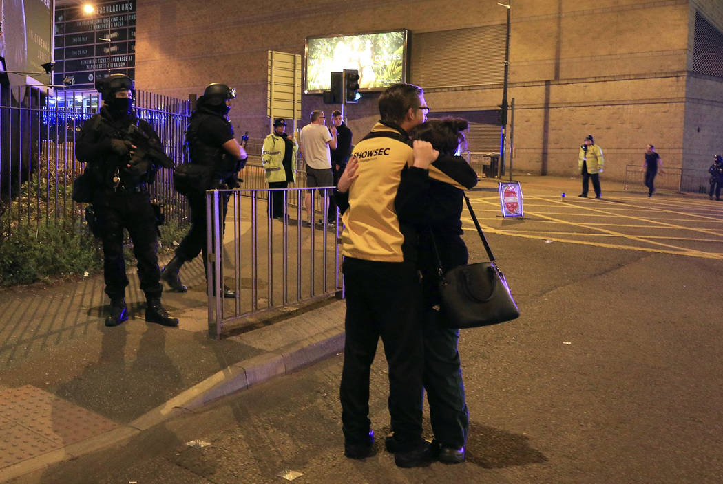 "Armed police stand guard at Manchester Arena after reports of an explosion at the venue during an Ariana Grande gig  in Manchester, England Monday, May 22, 2017. Police says there are ""a  ..."