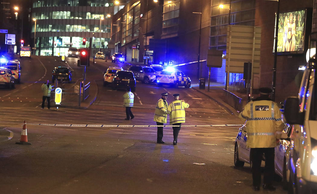 Emergency services work at Manchester Arena after reports of an explosion at the venue during an Ariana Grande gig in Manchester, England Monday, May 22, 2017. (Peter Byrne/PA via AP)