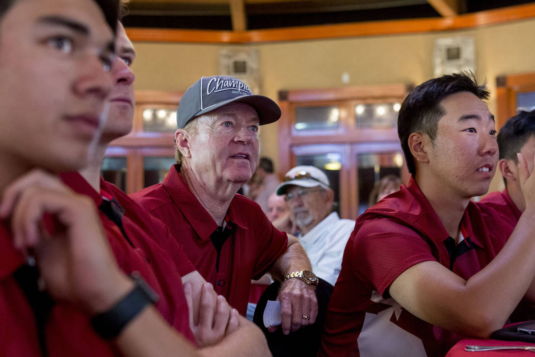 UNLV men's golf head choach Dwaine Knight, center, waits with his team to hear where they will be selected to play for the NCAA 2017 men's regionals at the Las Vegas Country Club in Las Vegas, Thu ...