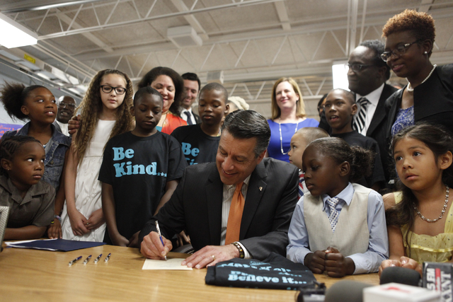 Governor Sandoval signs SB432 at Matt Kelly Elementary on Wednesday, June 3, 2015 in Las Vegas. The New Victory Schools program gives extra money to Nevada's poorest schools. (James Tensuan/Las Ve ...