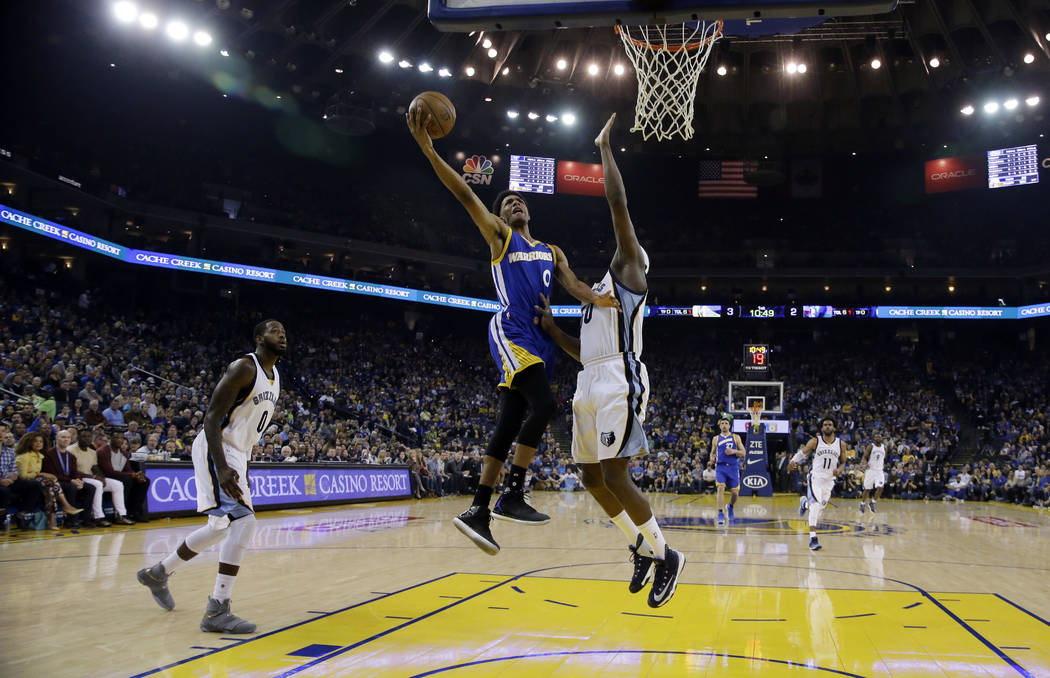 Golden State Warriors' Patrick McCaw drives to the basket against the Memphis Grizzlies during the first half of an NBA basketball game Sunday, March 26, 2017, in Oakland, Calif. (AP Photo/Jeff Chiu)