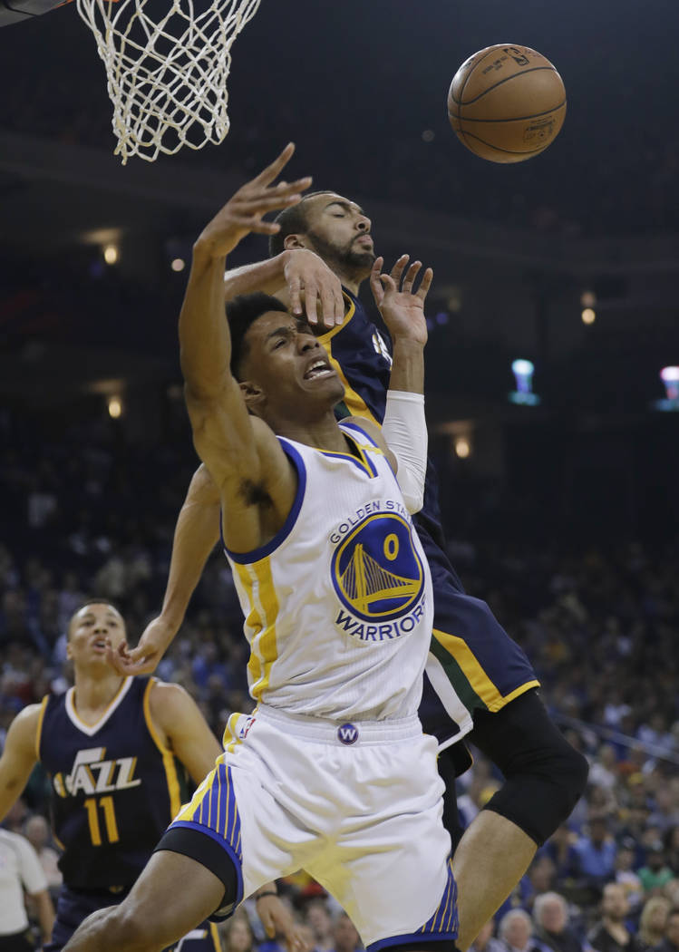 Golden State Warriors guard Patrick McCaw (0) has his shot blocked by Utah Jazz center Rudy Gobert during the first half of an NBA basketball game, Monday, April 10, 2017, in Oakland, Calif. (AP P ...