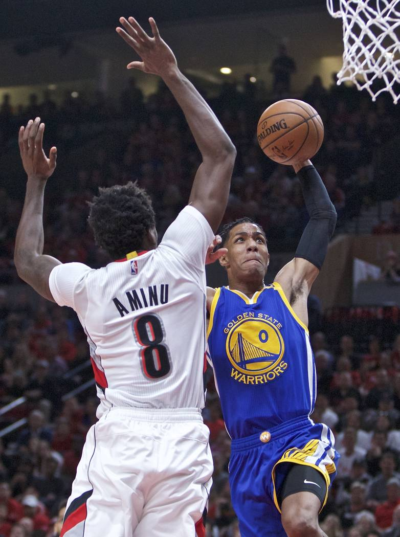Golden State Warriors guard Patrick McCaw, right, shoots over Portland Trail Blazers forward Al-Farouq Aminu during the first half of Game 3 of an NBA basketball first-round playoff series Saturda ...