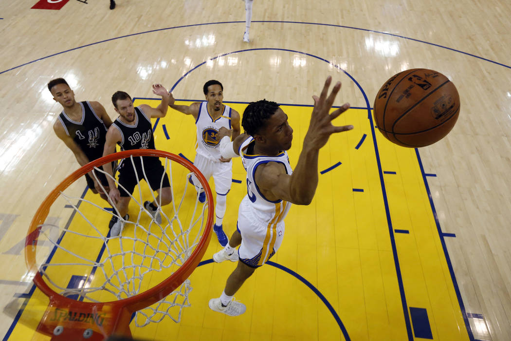 Golden State Warriors' Patrick McCaw grabs a rebound against the San Antonio Spurs during the first half of Game 2 of the NBA basketball Western Conference finals, Tuesday, May 16, 2017, in Oaklan ...