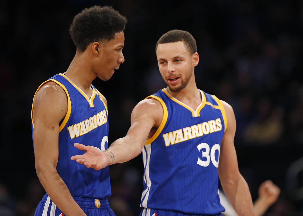 Golden State Warriors guard Stephen Curry (30) gestures as he talks to Warriors guard Patrick McCaw (0) during a time out in the second half of an NBA basketball game at Madison Square Garden in N ...
