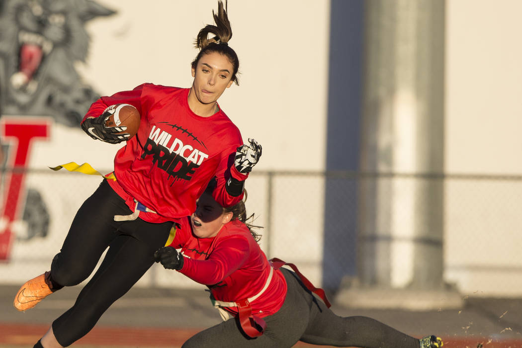 Las Vegas wide receiver Natalie Gennuso, left, runs for extra yardage after a catch during flag football practice at Las Vegas High School on Monday, Nov. 28, 2016, in Las Vegas. Benjamin Hager/La ...