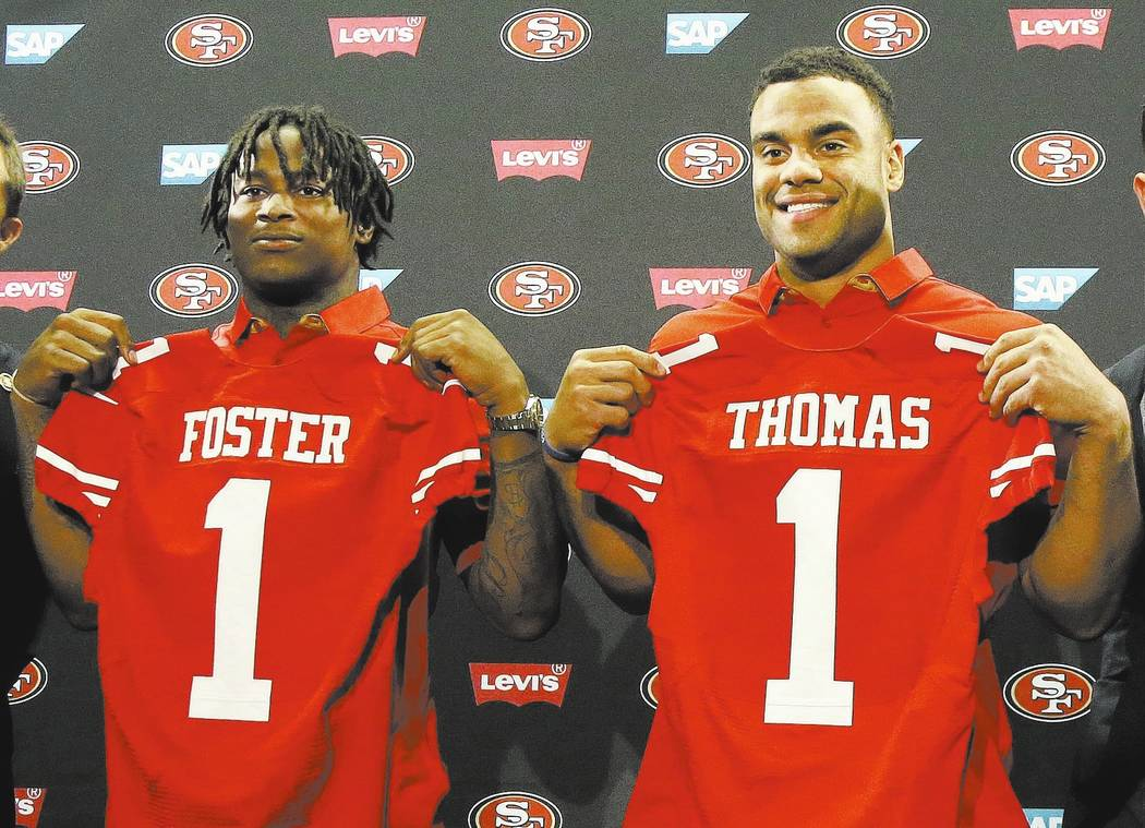 San Francisco 49ers draft picks Reuben Foster and Solomon Thomas stand for photos at a news conference Friday, April 28, 2017, in Santa Clara, California. (Jeff Chiu/The Associated Press)