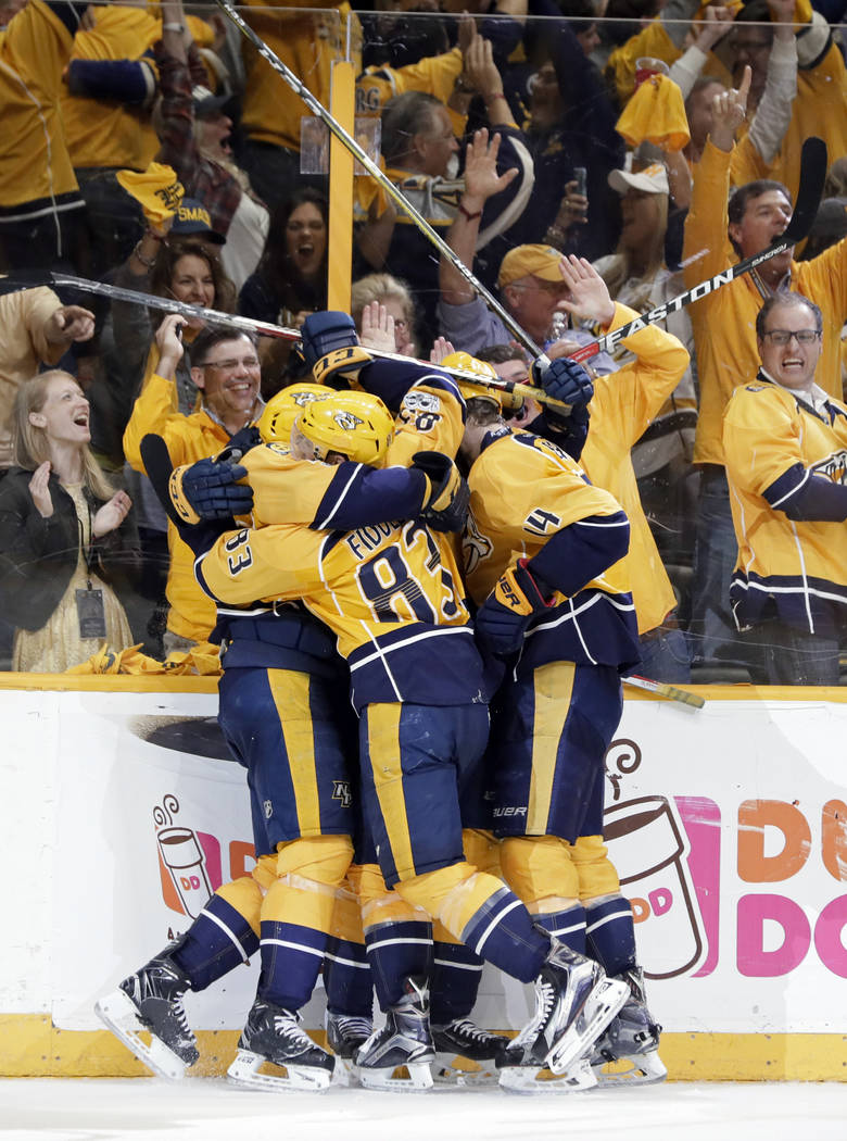Nashville Predators players celebrate after an empty-net goal against the Anaheim Ducks during the third period in Game 6 of the Western Conference final in the NHL hockey Stanley Cup playoffs Mon ...