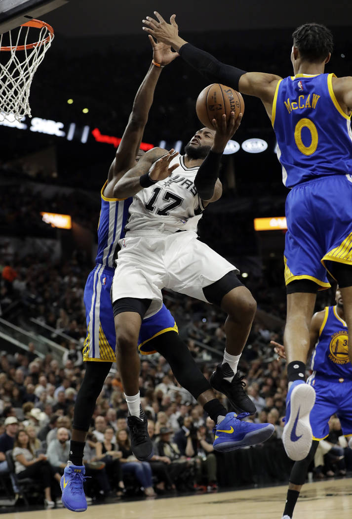 San Antonio Spurs' Jonathon Simmons (17) goes up for a shot that Golden State Warriors' Patrick McCaw (0) blocked during the second half in Game 4 of the NBA basketball Western Conference finals,  ...