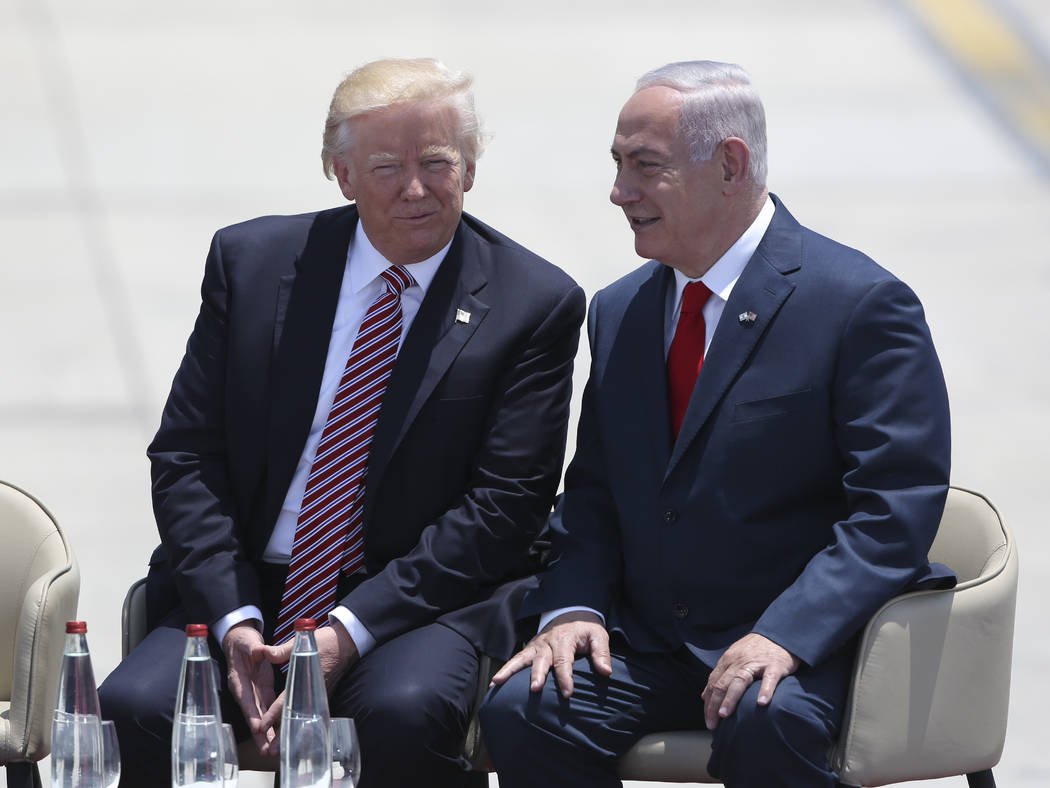US President Donald Trump and Israeli Prime Minister Benjamin Netanyahu talk during welcome ceremony in Tel Aviv, Monday, May 22,2017. (AP Photo/Oded Balilty)