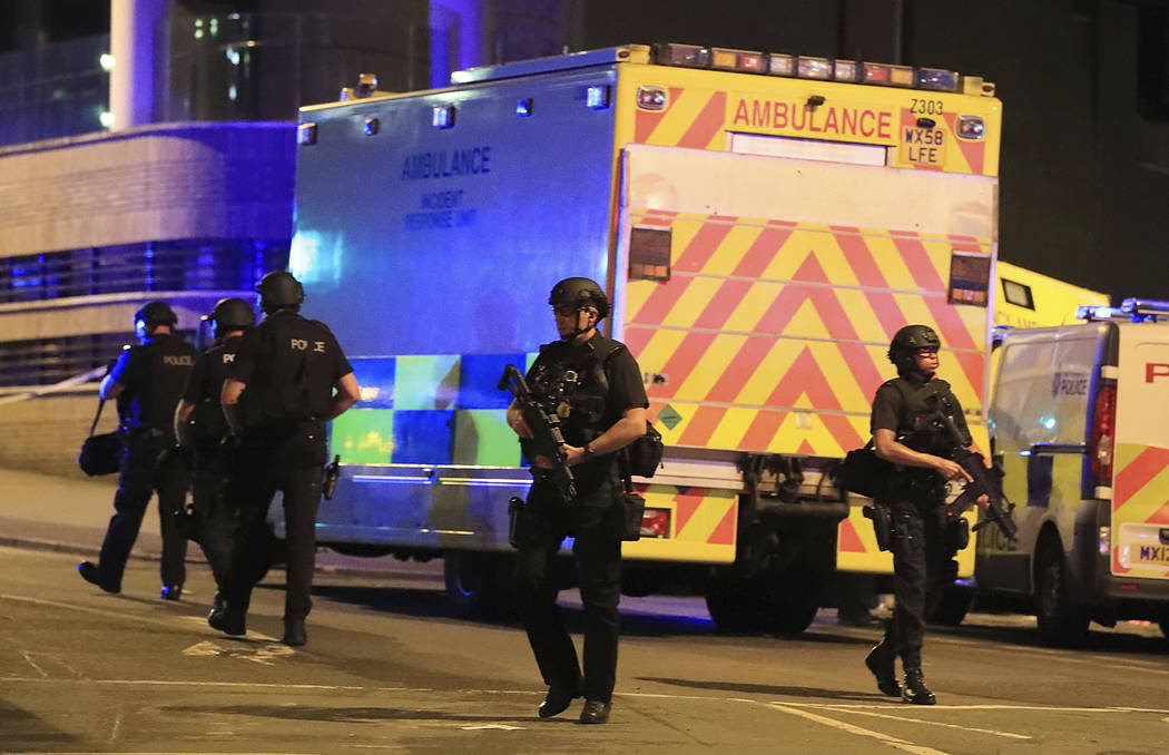 Armed police work at Manchester Arena after reports of an explosion at the venue during an Ariana Grande gig in Manchester, England Monday, May 22, 2017. Several people have died following reports ...