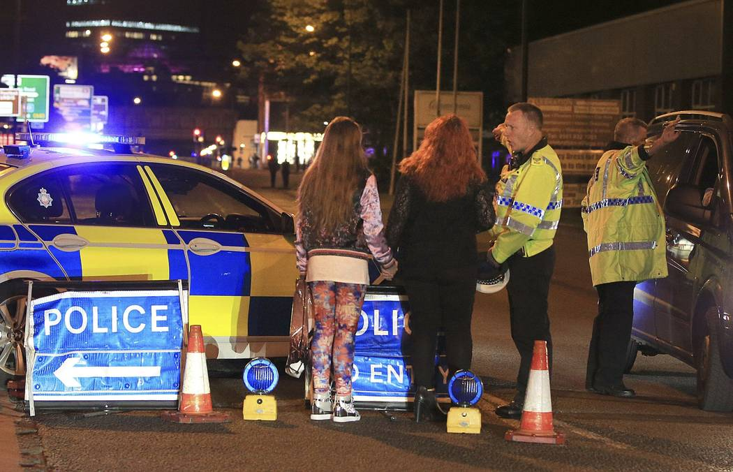 Police work at Manchester Arena after reports of an explosion at the venue during an Ariana Grande gig in Manchester, England Monday, May 22, 2017. Several people have died following reports of an ...