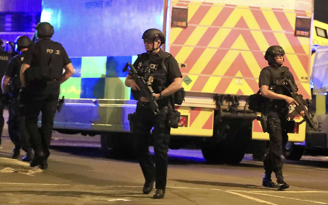 Armed police respond after reports of an explosion at Manchester Arena during an Ariana Grande concert in Manchester, England, Monday, May 22, 2017. Several people have died following reports of a ...