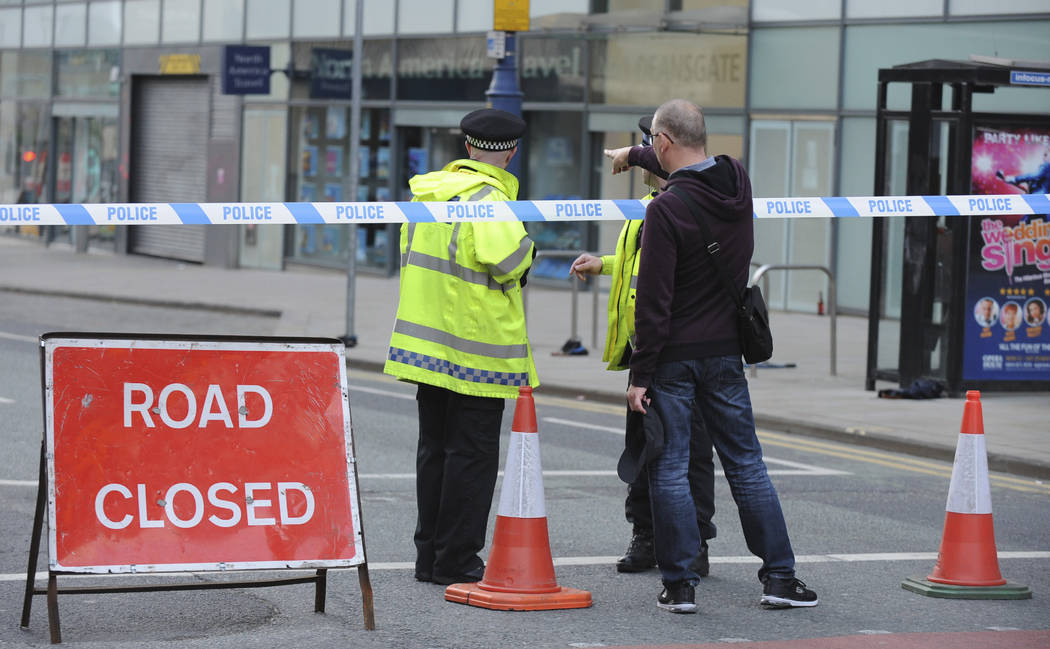 Police block a road near to the Manchester Arena in central Manchester, England Tuesday, May 23, 2017. An explosion struck an Ariana Grande concert attended by thousands of young music fans in nor ...